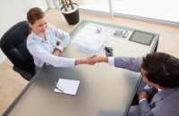 Above view of consultant shaking hands with her client
