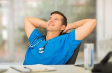attractive medical doctor relaxing in office