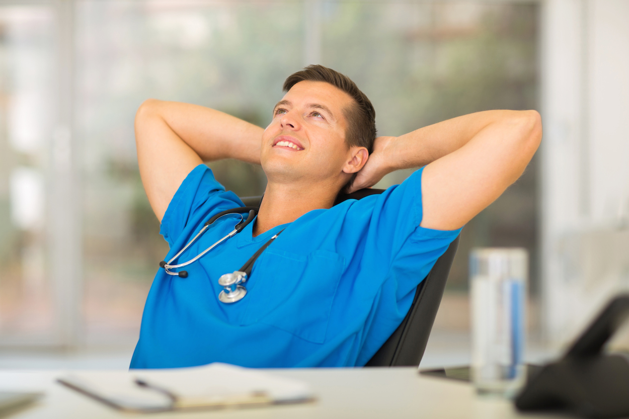 dressing appropriately for your healthcare job interview can make attractive medical doctor relaxing in office